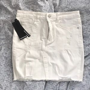 NEW with tags distressed white denim mini skirt